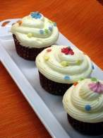 CARROT CUPCAKES WITH ORANGE CREAM CHEESE ICING